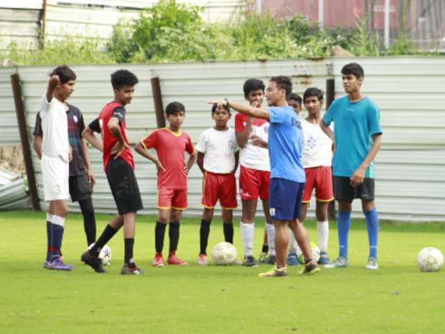 james tonsing coaching boys for football